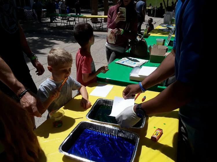Children partake in an art activity at Birmingham Botanical Gardens' Earth Day event