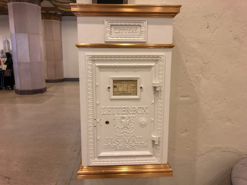 The restored US Mail Letter Box remains in the lobby at TJ Tower. Photo by Jon Eastwood for Bham Now.
