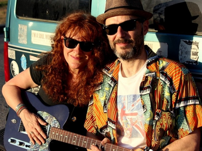 Photo blues musicians Debbie Bond, hold a guitar, and Radiator Rick. Both wear sunglasses. The pair is scheduled to play at the Market at Pepper Place 2019 in Birmingham, Alabama, on April 13