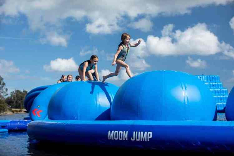 The inflatable water park at Oak Mountain State park has eight features guaranteed to make you wipeout! Photo via Flip Side Water Sports