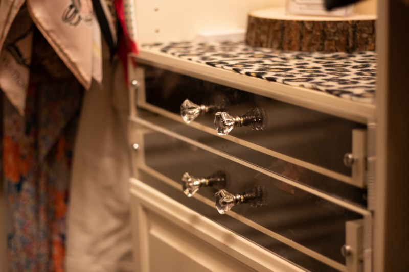 See-through drawer fronts are so pretty in this Closets by Design designer closet.