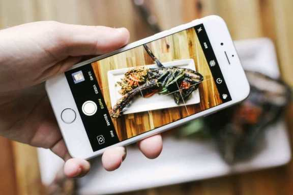 Picture of phone taking an image of food