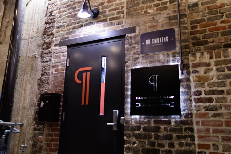 Pilcrow Cocktail Cellar is a speakeasy hidden between The Essential and Founders Station. If you weren't looking for it on a walking tour of Morris Ave, you'd totally miss it.