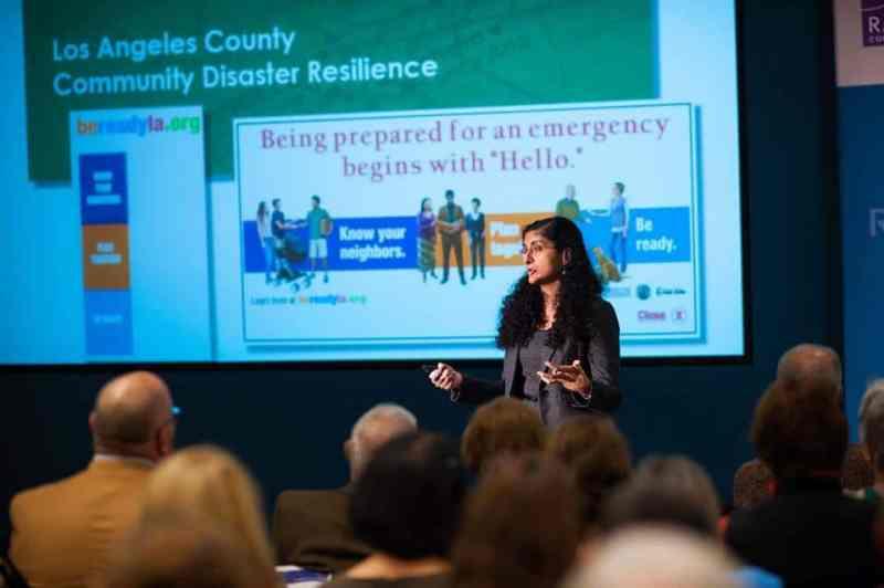 Dr. Anita Chandra providing a lecture