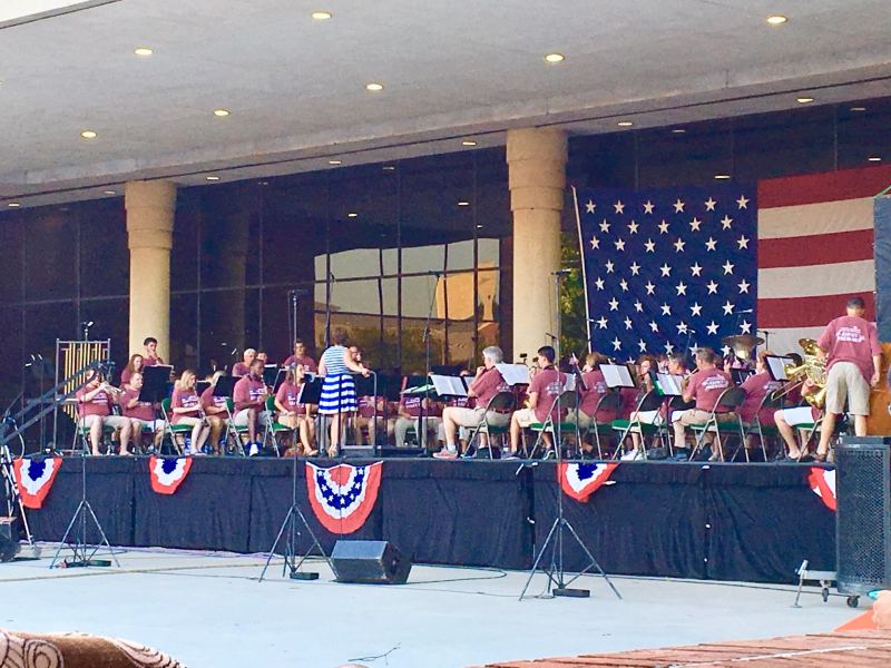 Pat Byington enjoys listening to the UAB Community Band concert for the 4th.