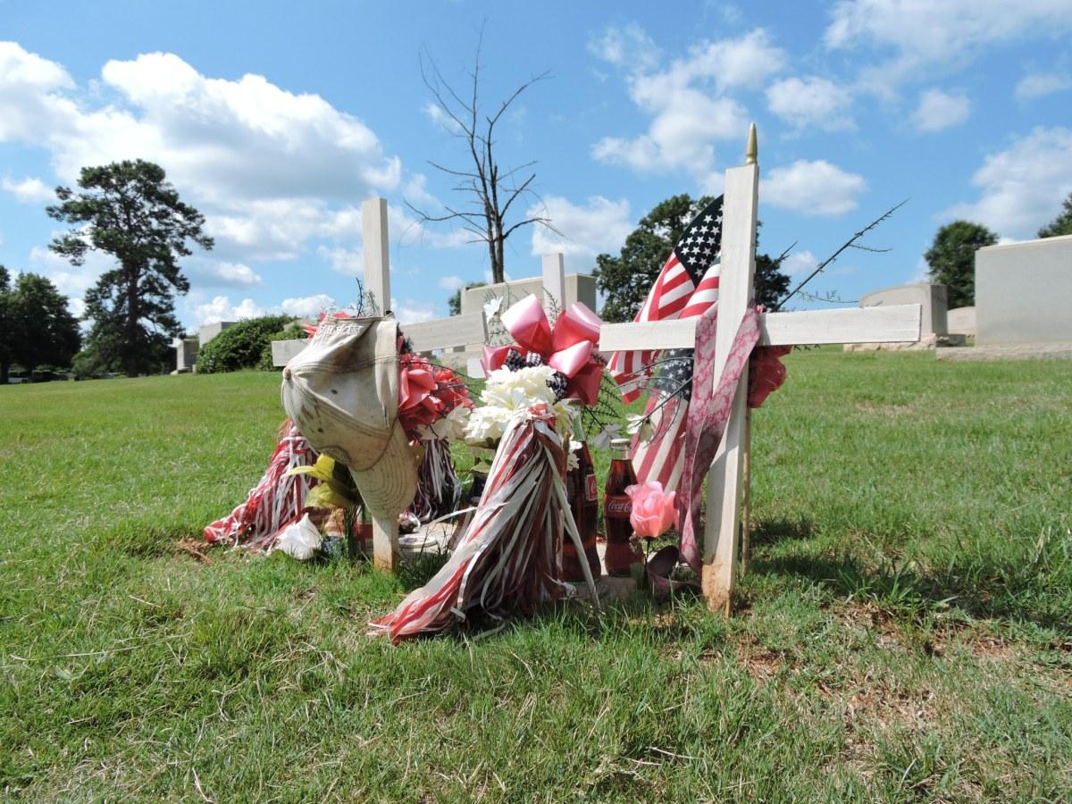 Notable figures buried in Oak Hill and Elmwood Cemeteries