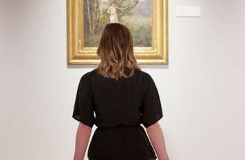 Woman looking at art