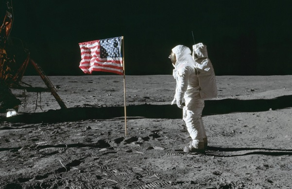 Astronaut standing on surface of moon