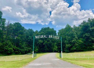 Sign above road. Road Trip to Natural Bridge of Alabama