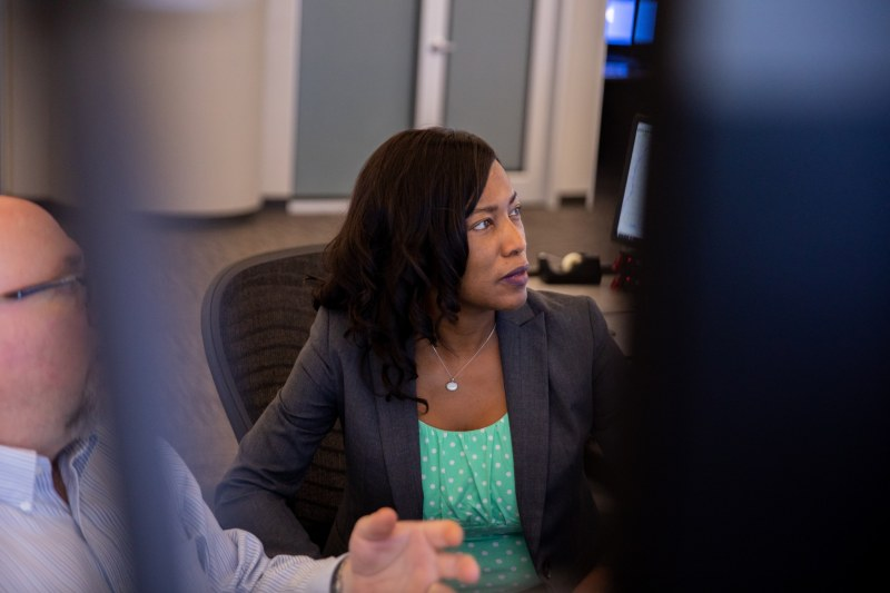 Shardra Scott in discussion with a colleague at Alabama Power's Birmingham Control Center