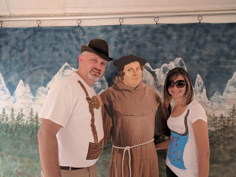 Guests pose with Martin Luther at Oktoberfest at Our Savior Lutheran Church