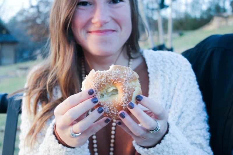 Woman holding bagel