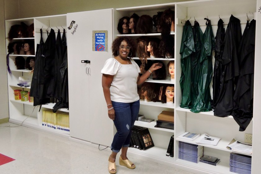 Sonya Pitts next to her new closets at Carver High School