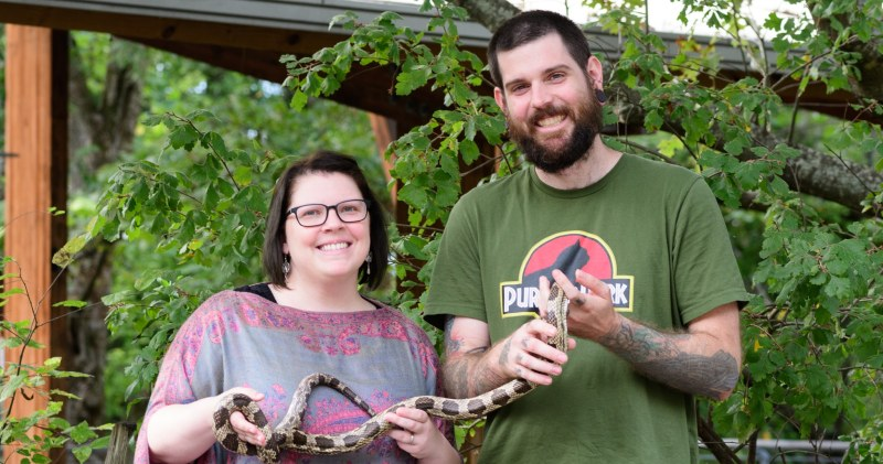 The folks at Ruffner Mountain holding a gray rat snake (nonvenomous)
