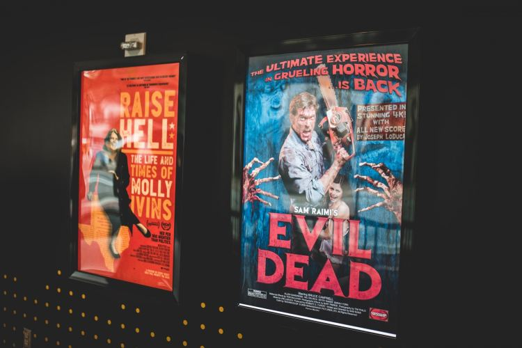 Two different movie posters are shown on the wall.