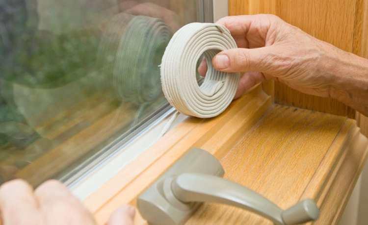 Sealing air leaks around a window.