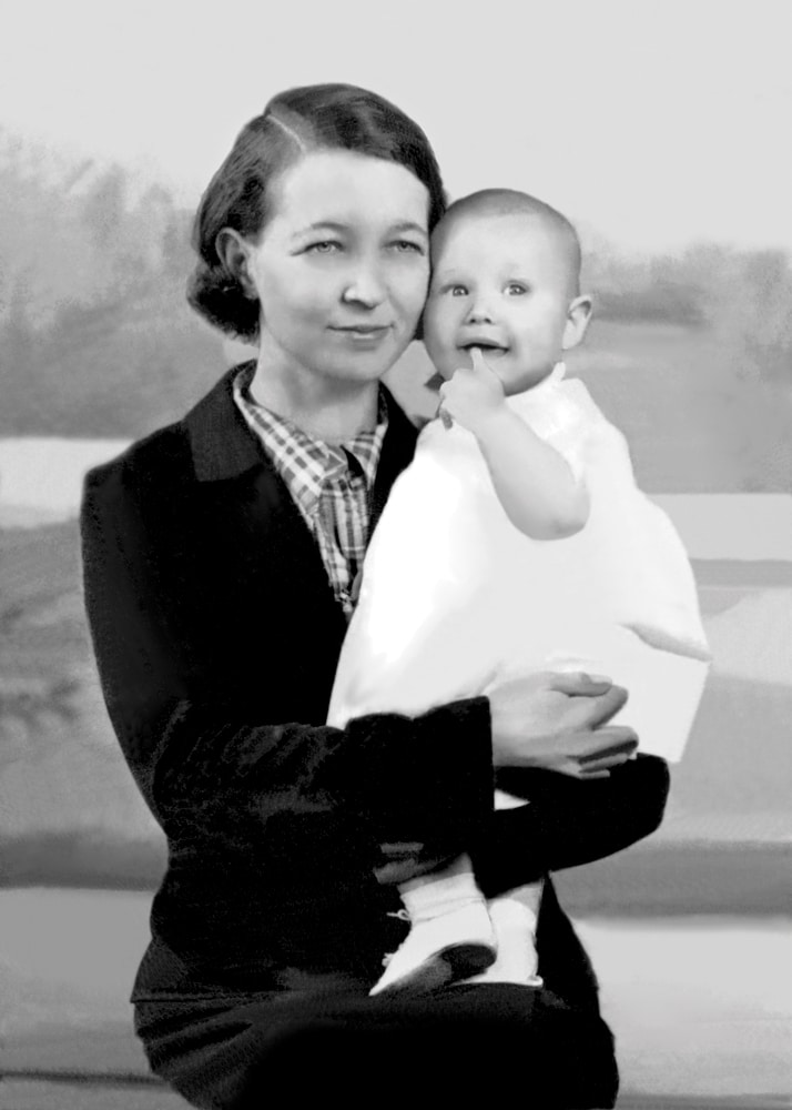 A restored version of an old photo. It depicts a woman holding a child.