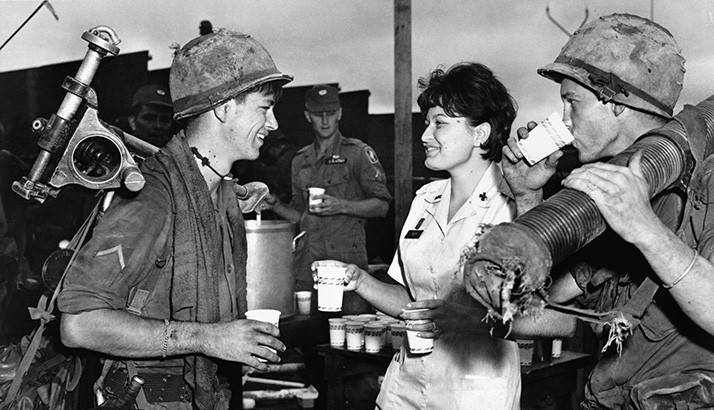 Red Cross volunteer gives coffee to soldiers in Vietnam