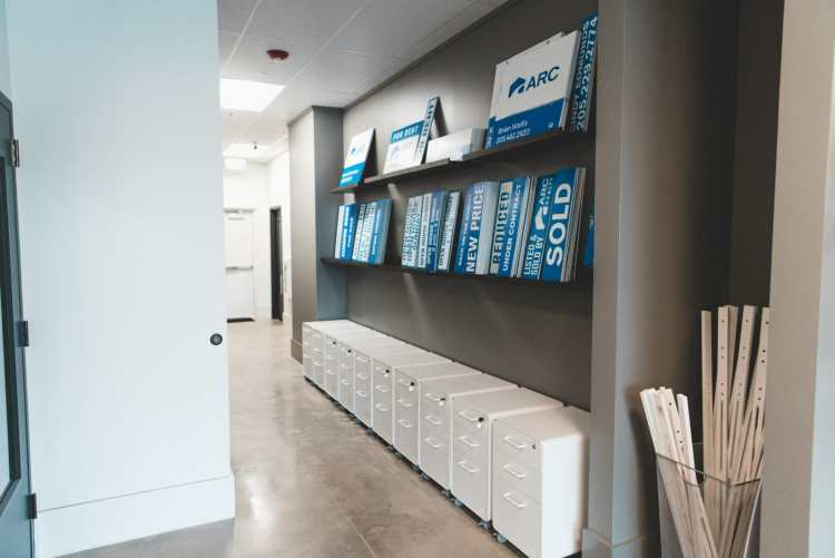 Signs and file cabinets at ARC Realty