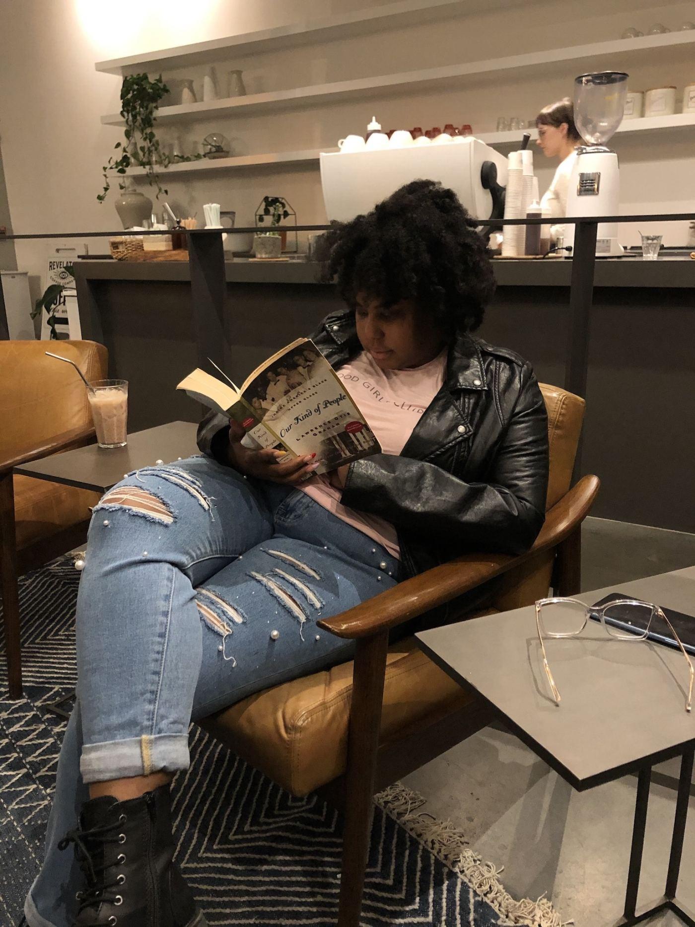 Photo of Christina Williams reading a book