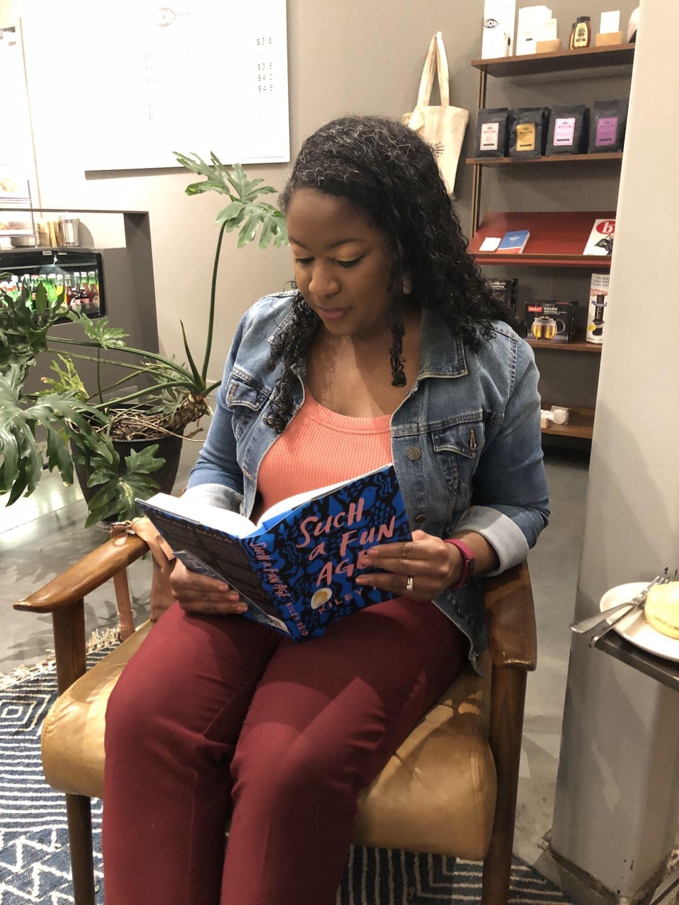 Photo of Javicia Harris Bowser reading a book