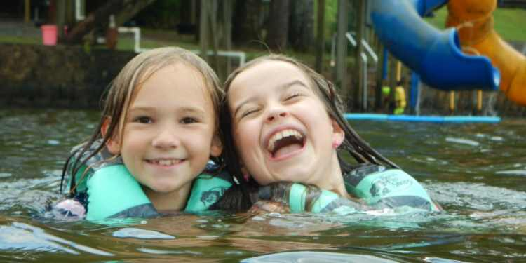 Girls swimming at Camp Cosby