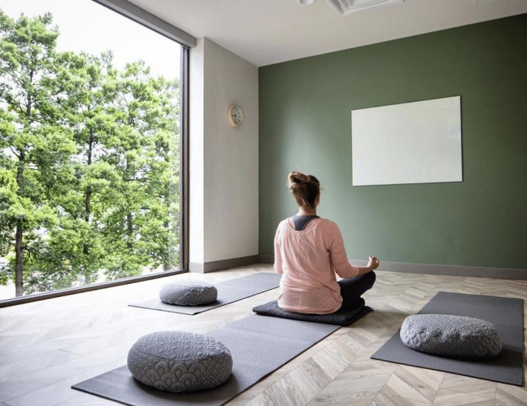 back of woman sitting meditating