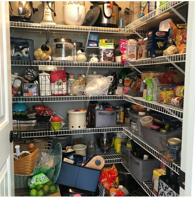 "a ""before"" picture of a pantry, not very kid-friendly"
