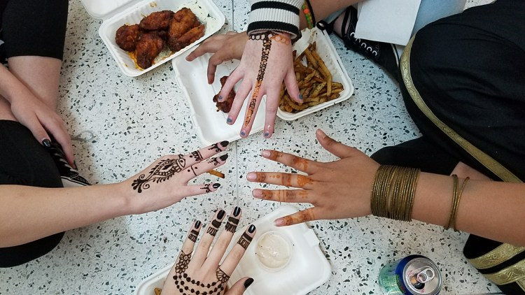 Women's hands decorated with henna at the Birmingham Museum of Art