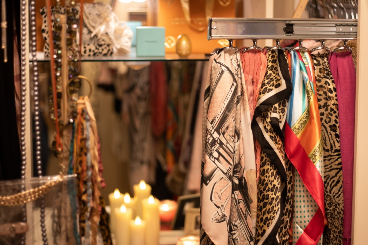scarves and candles in a closet