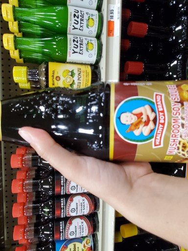 A glass bottle of mushroom soy sauce