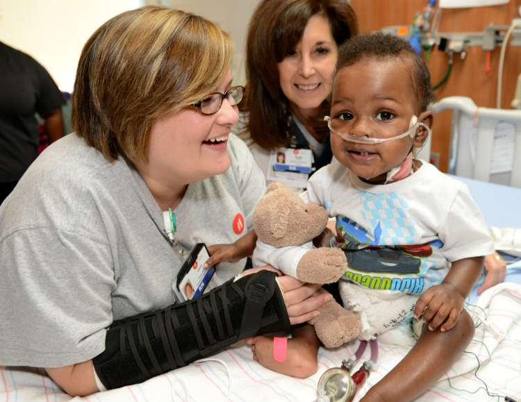 Nursing with a  small patient at Children's of Alabama