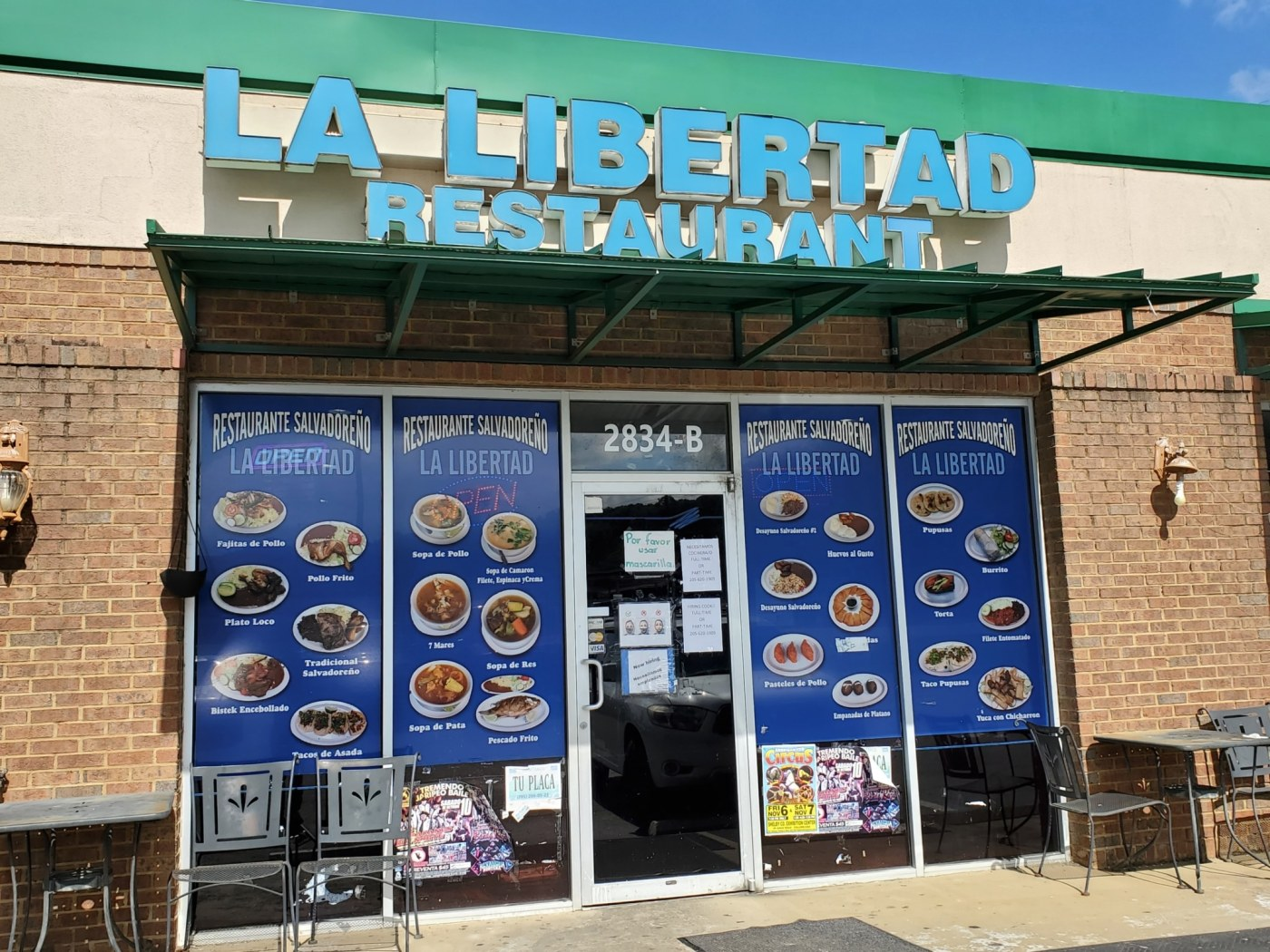 La Libertad storefront with pictures of menu items