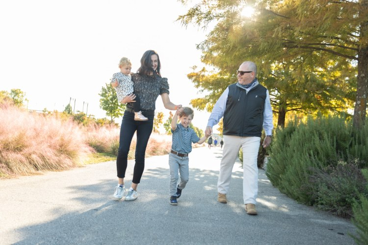 CEO of Orangetheory walking with family, Orangetheory holidays