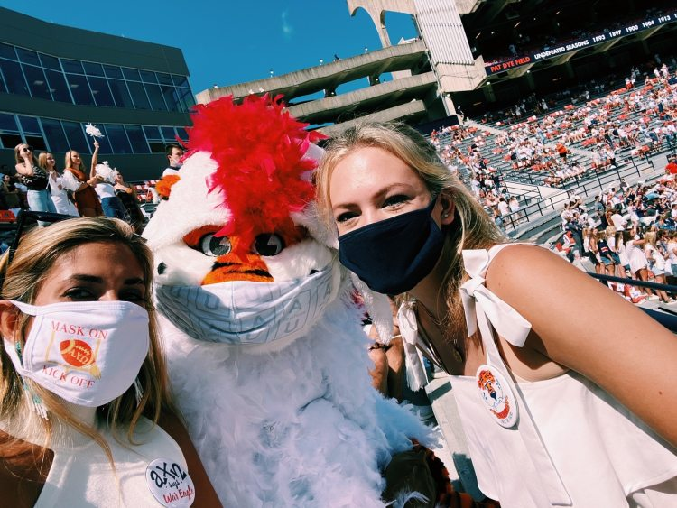 students wearing masks in the stadium at an Auburn game