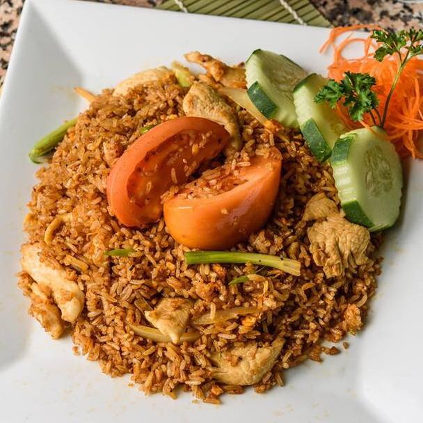 Thai fried rice with vegetable garnish