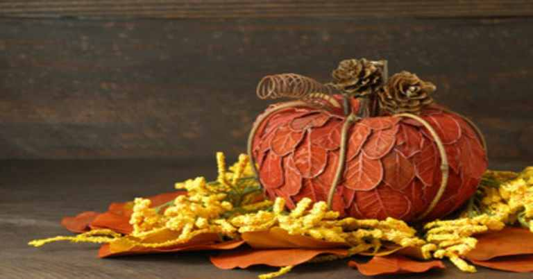 Picture of a pumpkin made of paper leaves