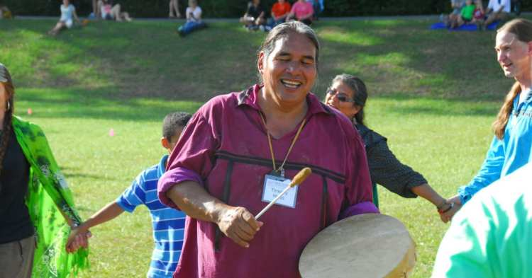 Native American man drumming at Moundville