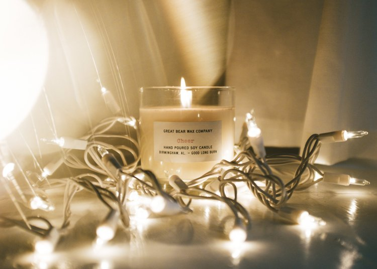 Great Bear Wax Company Cheer candle surrounded by Christmas lights