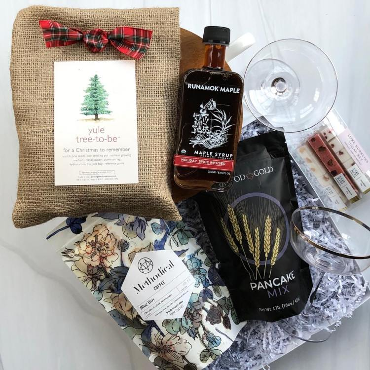 Gift box with maple syrup, glass, pancake mix and coffee