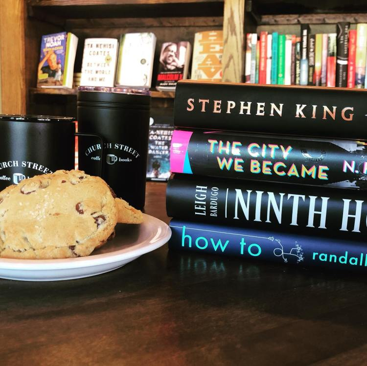 Stack of novels and breakup cookies