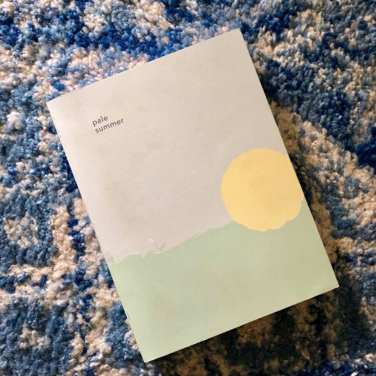 Poetry anthology on top of a colorful carpet - gift ideas for book lovers