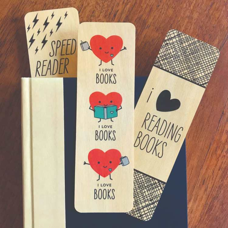 """Wooden bookmarks with phrases """"Speed Reader"""", """"I Love Books"""" and """"I Heart Reading Books"""""""