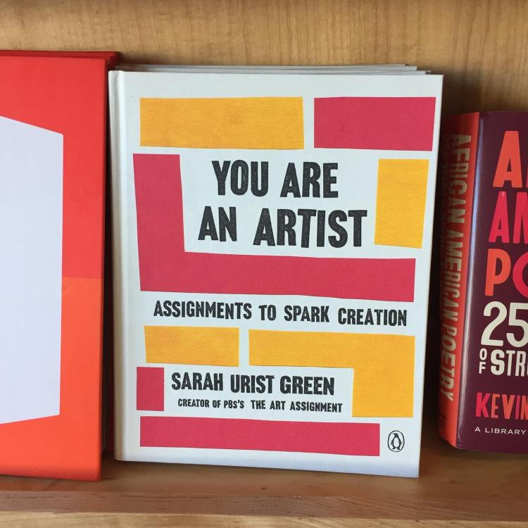 You Are An Artist book on a bookshelf; novel with red and yellow squares on cover