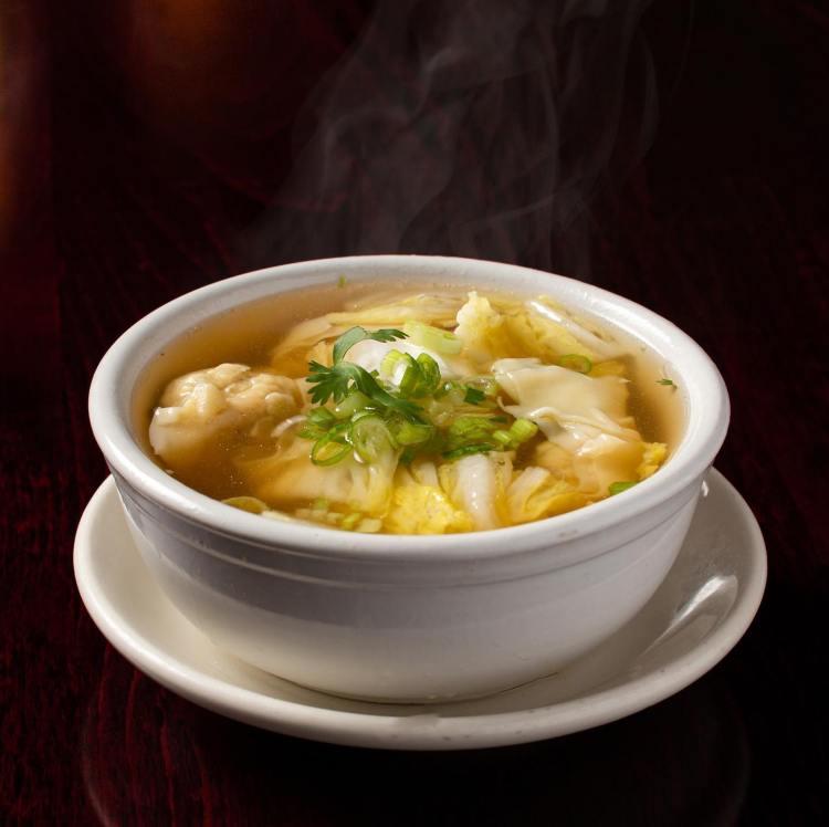 Bowl of hot dumpling soup
