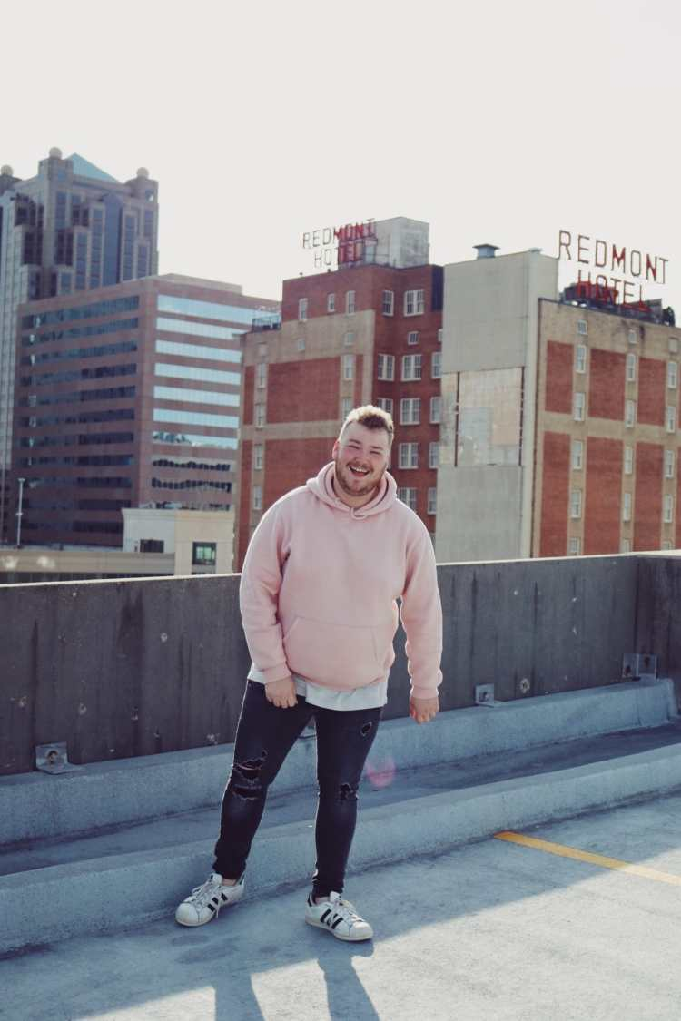 Maloney on a rooftop in Birmingham while doing UNA's online BBA program