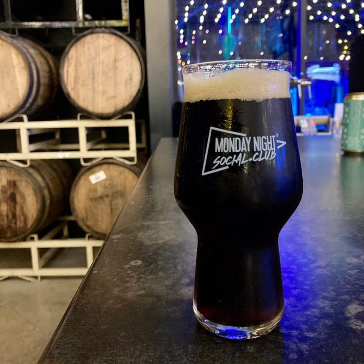a pint glass of Monday Night Brewing's Drafty Kilt Scoth Ale