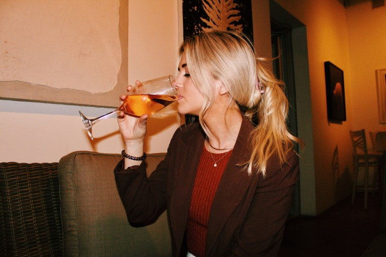 person sipping wine deals for national wine day