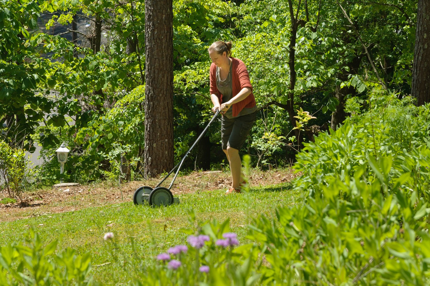 woman cutting grass, replace lawn