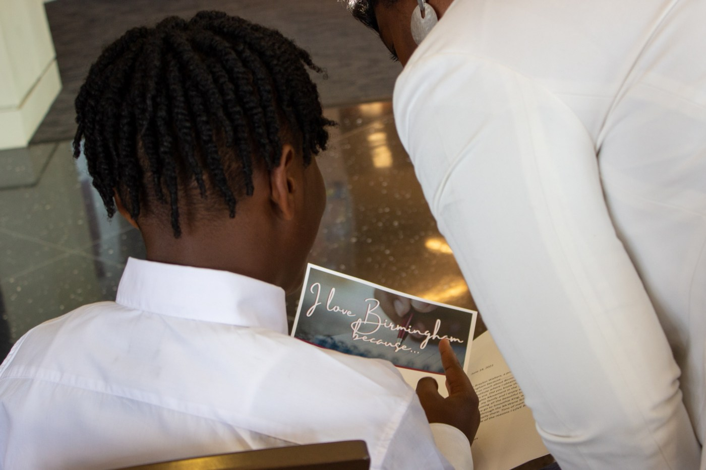 A Birmingham sixth grader read his love letter to Birmingham during the celebrations announcement. Photo by Libby Foster for Bham Now.